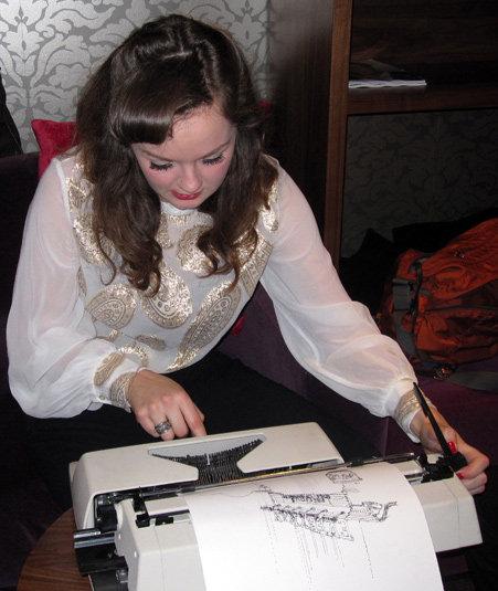 Keira typing away at her typewriter.